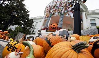 Halloween decorations on the South Portico of the White House await trick-or-treaters in Washington, Friday, Oct. 31, 2014. President Barack Obama and first lady Michelle Obama will welcome local children and children of military families to 'trick-or-treat' at the White House for Halloween. (AP Photo/Jacquelyn Martin)