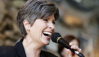 Republican Senate candidate Joni Ernst laughs during a campaign stop in Council Bluffs, Iowa, Friday, Oct. 31, 2014. Ernst is running against Democrat Bruce Braley for the Senate seat of Tom Harkin, who is not seeking reelection. (AP Photo/Nati Harnik)