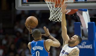 The Clippers' Jordan Farmar tries to stop the Thunder's Russell Westbrook during the Clippers' 93-90 victory over the Oklahoma City Thunder in their season opener at Staples Center Thursday night Oct. 30, 2014. (AP Photo/The Orange County Register, Kevin Sullivan)
