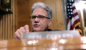 FILE - In this July 9, 2014 file photo, Sen. Tom Coburn, R-Okla. speaks on Capitol Hill in Washington. Coburn requested a Government Accountability Office report which showed nearly 60,000 veterans collected more than $3.5 billion in 2013 in military retirement pay, disability benefits from Veterans Affairs and disability checks from Social Security. Coburn said officials should fulfill promises to veterans, but work to streamline duplicative programs. (AP Photo/Susan Walsh, File)
