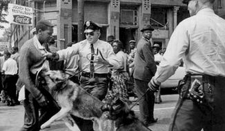 Parker High School student Walter Gadsden attacked by dogs in Alabama on May 4, 1963. (Associated Press) ** FILE **
