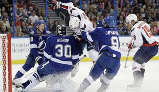 Washington Capitals right wing Eric Fehr (16) takes down Tampa Bay Lightning goalie Ben Bishop (30) during the first period of an NHL hockey game Saturday, Nov. 1, 2014, in Tampa, Fla. Lightning's Ondrej Palat (18) and Tyler Johnson (9) and Capitals' Nicklas Backstrom (19) are in on the play. Fehr was penalized for interference. (AP Photo/Chris O'Meara)