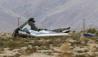 Wreckage lies near the site where a Virgin Galactic space tourism rocket, SpaceShipTwo, exploded and crashed in Mojave, Calif.  Friday, Oct. 31, 2014.  The explosion killed a pilot aboard and seriously injured another while scattering wreckage in Southern California's Mojave Desert, witnesses and officials said. (AP Photo/Ringo H.W. Chiu)