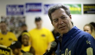 Kansas Republican Gov. Sam Brownback talks to supporters during a campaign event Saturday, Nov. 1, 2014, in Topeka, Kan. (AP Photo/Charlie Riedel)