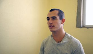 FILE - This May 3, 2014, file photo shows Sgt. Andrew Tahmooressi left, who is being held at Tijuana's La Mesa Penitentiary. A Mexican judge Friday Oct. 31, 2014 ordered the immediate release of a jailed U.S. Marine veteran who spent eight months behind bars for crossing the border with loaded guns. (AP Photo/UT San Diego, Alejandro Tamayo, File)