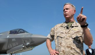 Former Marine Corps Commandant Gen. James Amos is getting support from Defense Secretary Hagel, who said the disputed official resume was not created by Gen. Amos but rather by a data center. (Associated Press)