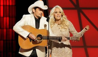 Brad Paisley and Carrie Underwood are again set to host the annual Country Music Association Awards. ABC will broadcast the 48th annual awards show Wednesday at 8 p.m. (Associated Press photographs)