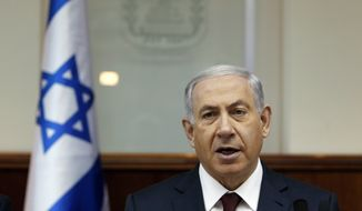 Israel's Prime Minister Benjamin Netanyahu chairs the weekly cabinet meeting in Jerusalem, Sunday, Nov. 2, 2014. (AP Photo/Ronen Zvulun, Pool)