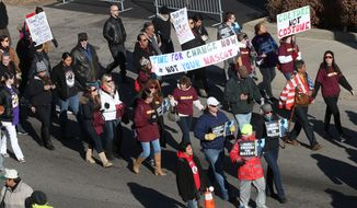 Protestors march outside TCF Bank Stadium before an NFL football game between the Minnesota Vikings and the Washington Redskins, Sunday, Nov. 2, 2014, in Minneapolis. The group was protesting the use of the mascot and name of the Washington Redskins football team. (AP Photo/Jim Mone)