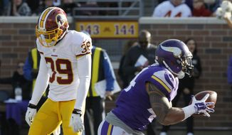 Minnesota Vikings running back Matt Asiata, right, celebrates in front of Washington Redskins cornerback David Amerson (39) after scoring on a 7-yard touchdown run during the second half of an NFL football game, Sunday, Nov. 2, 2014, in Minneapolis. (AP Photo/Ann Heisenfelt)