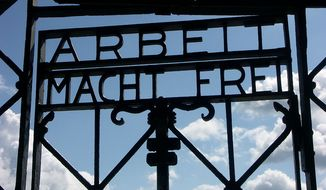 """The infamous sign bearing the words """"Arbeit Macht Frei"""" (""""Work will set you free"""") at the former Dachau concentration camp has been stolen, German police said on Sunday. (Wikipedia)"""