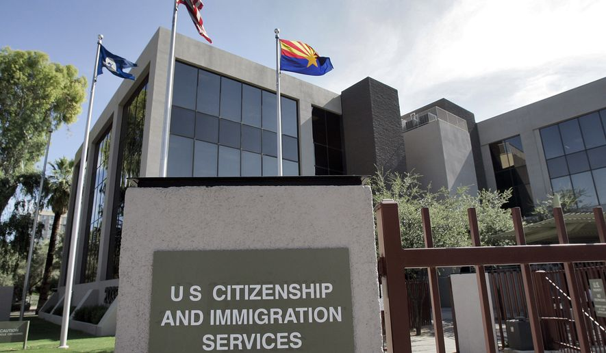 The U.S. Citizenship and Immigration Services building in Phoenix is seen here on Aug. 5, 2008. (Associated Press) **FILE**