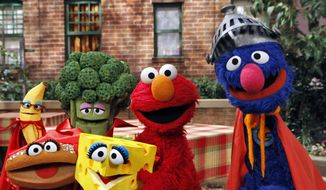 """This June 22, 2010 photo released by Sesame Workshop, """"Sesame Street"""" characters Elmo, second from right, and Super Grover, right, pose with four new muppets representing healthy food groups; fruits, vegetables, dairy, and grains as part of their """"Food For Thought: Eating Well on a Budget"""" initiative in New York. Sesame Street continues to attract millions of viewers after 45 years on the air, appealing to both preschoolers and their parents with content that is educational and entertaining. The show has kept up with the times by making its segments faster-paced, by fine-tuning messages, and by keeping a steady flow of appearances by contemporary celebrity guests. The show first aired Nov. 10, 1969. (AP Photo/Sesame Workshop, Richard Termine, File)"""