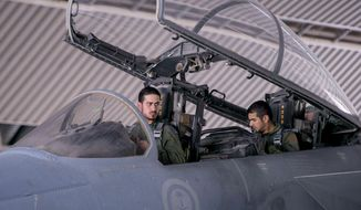 In this file photo released Wednesday, Sept. 24, 2014, by the official Saudi Press Agency, Saudi pilots sits in the cockpit of a fighter jet as part of U.S.-led coalition airstrikes on Islamic State militants and other targets in Syria. (AP Photo/Saudi Press Agency, File)