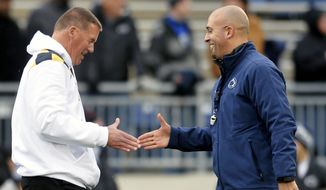 Maryland head coach Randy Edsall and Penn State head coach James Franklin shake hands before an NCAA college football game against Penn State at Beaver Stadium, Saturday, Nov. 1, 2014, in State College, Pa. (AP Photo/York Daily Record,  Chris Dunn)