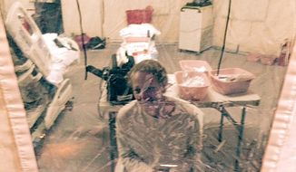 This Sunday, Oct. 26, 2014 photo provided by attorney Steven Hyman shows nurse Kaci Hickox in an isolation tent at University Hospital in Newark, N.J., where she was quarantined after flying into Newark Liberty International Airport following her work in West Africa caring for Ebola patients. On Monday New Jersey officials said Hickox was being released, had been symptom-free for 24 hours and would be taken on a private carrier to Maine. Hickox had complained about her treatment in New Jersey and in a telephone interview with CNN said she did not initially have a shower, flushable toilet, television or reading material in the special tent she was placed in. (AP Photo/Steven Hyman) MANDATORY CREDIT