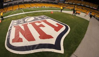 This is the NFL logo on the field at Heinz Field before an NFL football game between the Pittsburgh Steelers and the Baltimore Ravens, Sunday, Nov. 2, 2014, in Pittsburgh. (AP Photo/Gene J. Puskar)