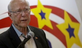 Republican Kansas Sen. Pat Roberts talks to supporters at the Johnson County Republican headquarters, Monday, Nov. 3, 2014, in Overland Park, Kan. Incumbent Roberts is locked in a tough contest with independent candidate Greg Orman in Tuesday's midterm election. (AP Photo/Charlie Riedel)