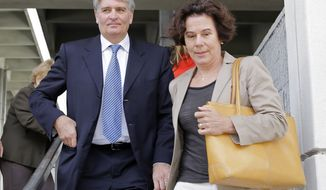 Raoul Weil, former top executive at Swiss bank UBS AG, leaves federal court for a lunch break with his wife Susan Lerch Weil, right, in Fort Lauderdale, Fla., Monday, Nov. 2, 2014. Weil is on trial for allegedly conspiring with thousands of wealthy Americans to conceal some $20 billion in assets from the Internal Revenue Service. After the prosecution rested last week, lawyers for Raoul Weil asked a judge to acquit him, contending the U.S. has not proved him guilty of any crime.(AP Photo/Alan Diaz)