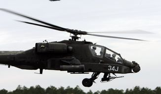 """The AH-64D Apache attack helicopter is used mostly by the Army but it also is found in other countries' military aviation fleets. Last year, authorities at Fort Rucker, Alabama, reported a """"mishap"""" in which an instructor and student were taken to a hospital but were unharmed, according to a local TV station. (Associated Press)"""