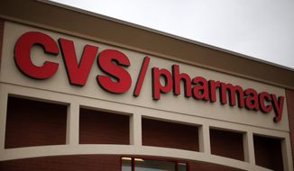 This March 17, 2014, photo shows a CVS/Pharmacy in Dormont, Pa. (AP Photo/Gene J. Puskar) ** FILE **