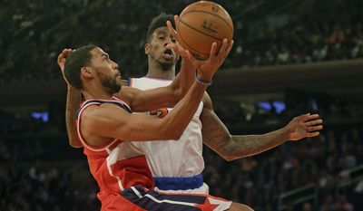 Washington Wizards' Garrett Temple (17) drives past New York Knicks' Iman Shumpert (21) during the first half of an NBA basketball game Tuesday, Nov. 4, 2014, in New York. (AP Photo/Frank Franklin II)