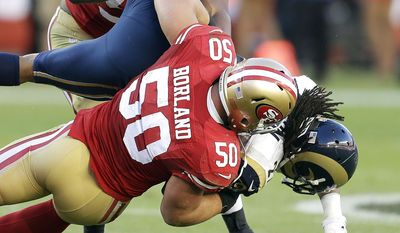 St. Louis Rams running back Tre Mason, right, is tackled by San Francisco 49ers inside linebacker Chris Borland (50) during the fourth quarter of an NFL football game in Santa Clara, Calif., Sunday, Nov. 2, 2014. (AP Photo/Ben Margot)