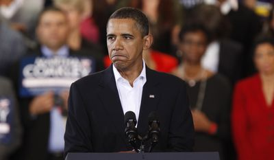 President Obama frowns while speaking at a campaign rally for Mass. Attorney General Martha Coakley, the Democratic candidate vying for the seat vacated by the death of U.S. Sen. Edward Kennedy, D-Mass., Sunday, Jan. 17, 2010, in Boston. (AP Photo/Michael Dwyer) **FILE**