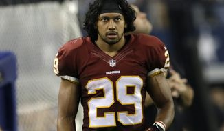 **FILE** Washington Redskins running back Roy Helu (29) walks along the team bench in the second half of an NFL football game against the Dallas Cowboys, Sunday, Oct. 13, 2013, in Arlington, Texas. (AP Photo/LM Otero)