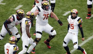 Maryland place kicker Brad Craddock (15) celebrates with teammates after kicking a 43-yard, game-winning field goal with 51 seconds left in the second half of an NCAA college football game against Penn State in State College, Pa., Saturday, Nov. 1, 2014. Maryland won 20-19. (AP Photo/Gene J. Puskar)