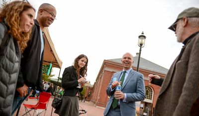 Independent candidate for mayor David Catania, second from right, greets people on the street at Eastern Market on election day, Washington, D.C., Tuesday, November 4, 2014. (Andrew Harnik/The Washington Times)