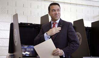Congressman Michael Grimm smiles after voting in the borough of Staten Island in New York, Tuesday, Nov. 4, 2014. The republican incumbent, who is under indictment on criminal charges, is in a close race with his democratic challenger, Domenic Recchia. (AP Photo/Seth Wenig)