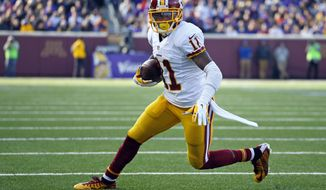Washington Redskins wide receiver DeSean Jackson (11) runs with the ball after making a catch against the Minnesota Vikings during an NFL football game, Sunday, Nov. 2, 2014, in Minneapolis. (Jeff Haynes/AP Images for Panini)