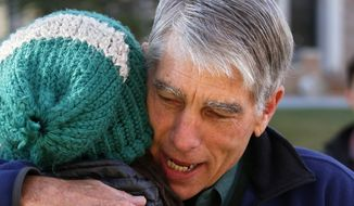 Sen. Mark Udall, D-Colo. hugs a supporter during a visit to the University of Colorado in Boulder, Colo., Election Day, Tuesday Nov. 4, 2014. (AP Photo/Brennan Linsley)