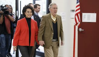 Senate Minority Leader Mitch McConnell of Ky., and his wife, former Labor Secretary Elaine Chao, arrive to cast their ballots in the midterm election at their voting precinct at Bellarmine University in Louisville, Ky., Tuesday, Nov. 4, 2014.  The Kentucky Senate race, with McConnell, a 30-year incumbent, facing a spirited challenge from Democrat Alison Lundergan Grimes, has been among the most combative and closely watched contests that could shift the balance of power in Congress. (AP Photo/J. Scott Applewhite)