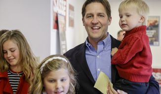 Republican Senate candidate Ben Sasse and his children from left: Elizabeth, Alexandra and Breck arrive to Sasse's campaign headquarters in Lincoln, Neb., Tuesday, Nov. 4, 2014. Sasse is running against Democrat Dave Domina for the Senate Seat of Mike Johanns, R-Neb., who is not seeking re-election. (AP Photo/Nati Harnik)
