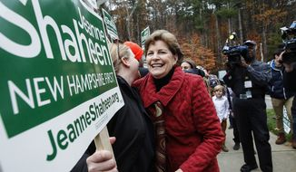 Sen. Jeanne Shaheen, D-N.H., hugs a volunteer holding a sign as she heads in to vote at the Town Hall in Madbury, NH,  Tuesday, Nov. 4, 2014.  Shaheen, a Democrat seeking a second term, faces Republican Scott Brown, who is seeking to represent a second state. Brown moved to New Hampshire last year after losing his U.S. Senate seat in Massachusetts.  (AP Photo/Cheryl Senter)