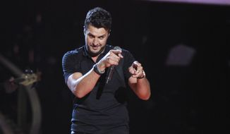 Luke Bryan performs onstage at the 48th annual CMA Awards at the Bridgestone Arena on Wednesday, Nov. 5, 2014, in Nashville, Tenn. (Photo by Wade Payne/Invision/AP)