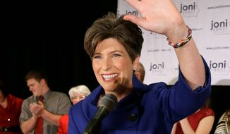 Sen.-elect Joni Ernst waves to supporters during an election night rally Nov. 4 in West Des Moines, Iowa. Ms. Ernst defeated Rep. Bruce Braley, Iowa Democrat, in the race to replace retiring Sen. Tom Harkin. (Associated Press)