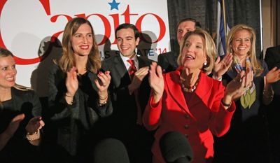 """West Virginia Republican Senate candidate Rep. Shelley Moore Capito applauds and sings """"I Gotta Feeling"""" by The Black Eyed Peas after winning the Senate seat,Tuesday, Nov. 4, 2014, at Embassy Suites in Charleston W.Va. (AP Photo/Tyler Evert)"""