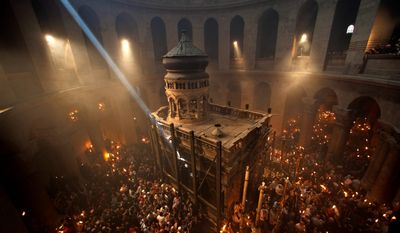 Christian pilgrims hold candles at the Church of the Holy Sepulchre, believed to be the burial site of Jesus Christ, during the ceremony of the Holy Fire.