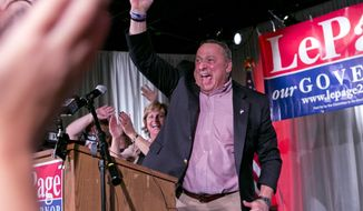 Gov. Paul LePage, with his wife Ann LePage, celebrates his re-election bid at his election night party, Tuesday, Nov. 4, 2014, in Lewiston, Maine. LePage defeated Democrat Mike Michaud and independent Eliot Cutler.  (AP Photo/Robert F. Bukaty)