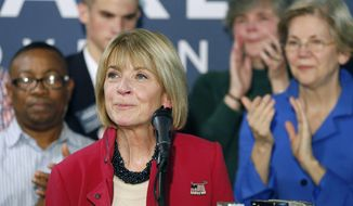Democrat Martha Coakley, center, pauses as she concedes defeat to Republican Charlie Baker in the Massachusetts governor's race, Wednesday, Nov. 5, 2014, in Somerville, Mass. Sen. Elizabeth Warren, right, looks on. Baker became the state's first Republican governor since Mitt Romney left office in 2007.  (AP Photo/Michael Dwyer)