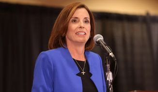 Martha McSally, candidate for Congressional District 2, makes a speech to supporters during a Republican election night party at the Sheraton Tucson Hotel and Suites, Tuesday, Nov. 4, 2014, in Tucson, Ariz. (AP Photo/Arizona Daily Star, Mamta Popat)