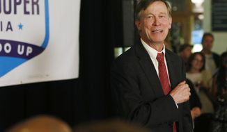 Colorado Gov. John Hickenlooper talks to supporters at an election night gathering in Union Station in downtown Denver on Tuesday, Nov. 4, 2014. Hickenlooper, the Democratic incumbent seeking his second, four-year term, told supporters to head home since the race against Republican banker Bob Beauprez was still undecided. (AP Photo/David Zalubowski)