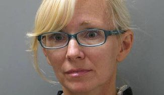 In this undated photo provided Wednesday, Nov. 5, 2014, by the Delaware State Police, Molly Shattuck, of Baltimore, poses for a police mug shot. Shattuck, 47, was indicted Monday, Nov. 3, 2014, on two counts of third-degree rape, four counts of unlawful sexual contact and three counts of providing alcohol to minors. (AP Photo/Delaware State Police)