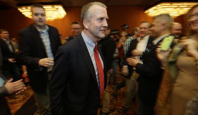 Republican U.S. Senate candidate Dan Sullivan walks to the stage to greet supporters on Election Night, Tuesday, Nov. 4, 2014, in Anchorage Alaska. (AP Photo/Ted S. Warren)
