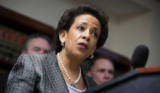 In this June 17, 2013, file photo, Loretta Lynch, United States Attorney for the Eastern District of New York, speaks during a news conference at the U.S. Attorney's office in the Brooklyn borough of New York. Lynch could be on a list of contenders to replace Eric Holder as Attorney General. If selected, Lynch would make history as the first black woman to lead the Justice Department. (AP Photo/John Minchillo, File)