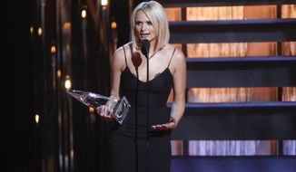 Miranda Lambert accepts the female vocalist of the year award on stage at the 48th annual CMA Awards at the Bridgestone Arena on Wednesday, Nov. 5, 2014, in Nashville, Tenn. (Photo by Wade Payne/Invision/AP)