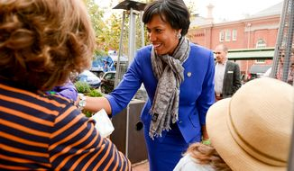 Democratic candidate for Mayor Muriel Bowser greets people on the street at Eastern Market on election day, Washington, D.C., Tuesday, November 4, 2014. (Andrew Harnik/The Washington Times) **FILE**